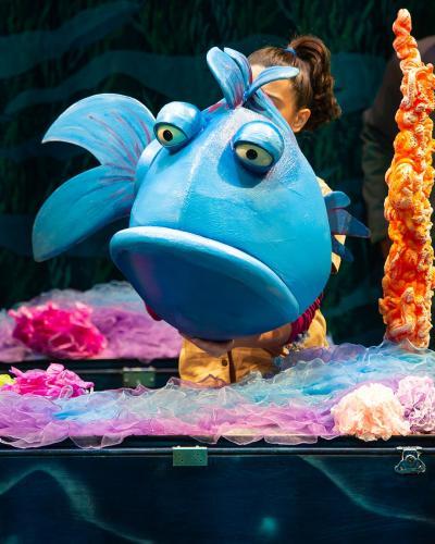 A blue fish pouting.