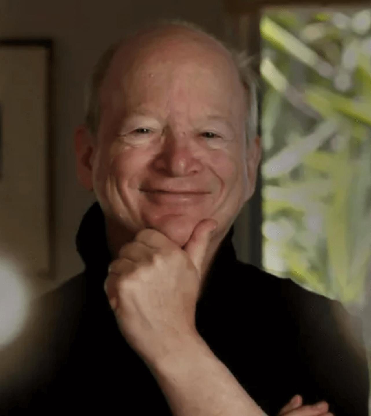 Bob Lefsetz smiling indoors.