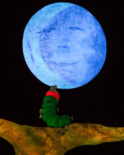The hungry caterpillar sits on a branch and stares up at the moon